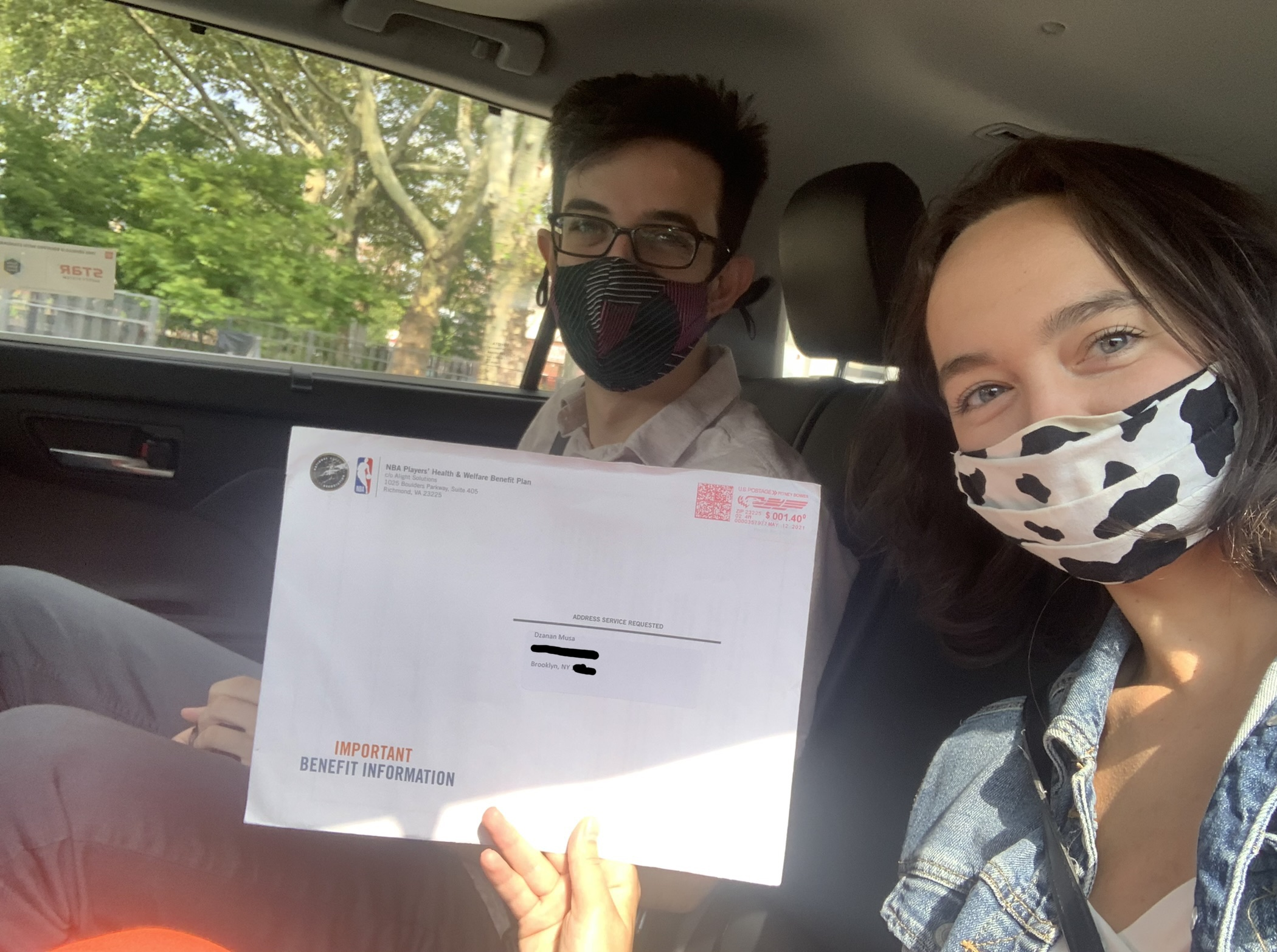 Laura Wagner and Samer Kalaf in a car with the important mail.