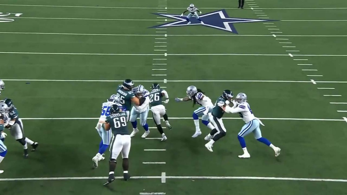 Miles Sanders breaks through the line for a big gain.