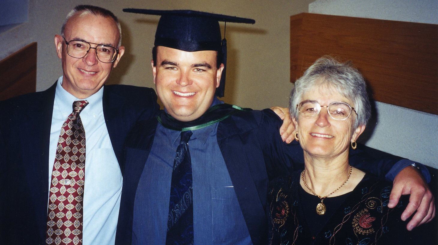 Photo of Andrew Bagby and his parents David and Kathleen Bagby at Andrew's graduation from medical school.