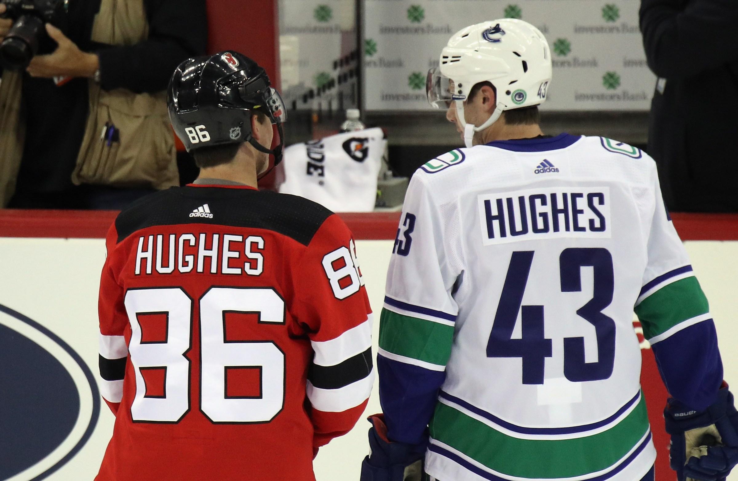 Jack Hughes and Quinn Hughes skate in warm-ups