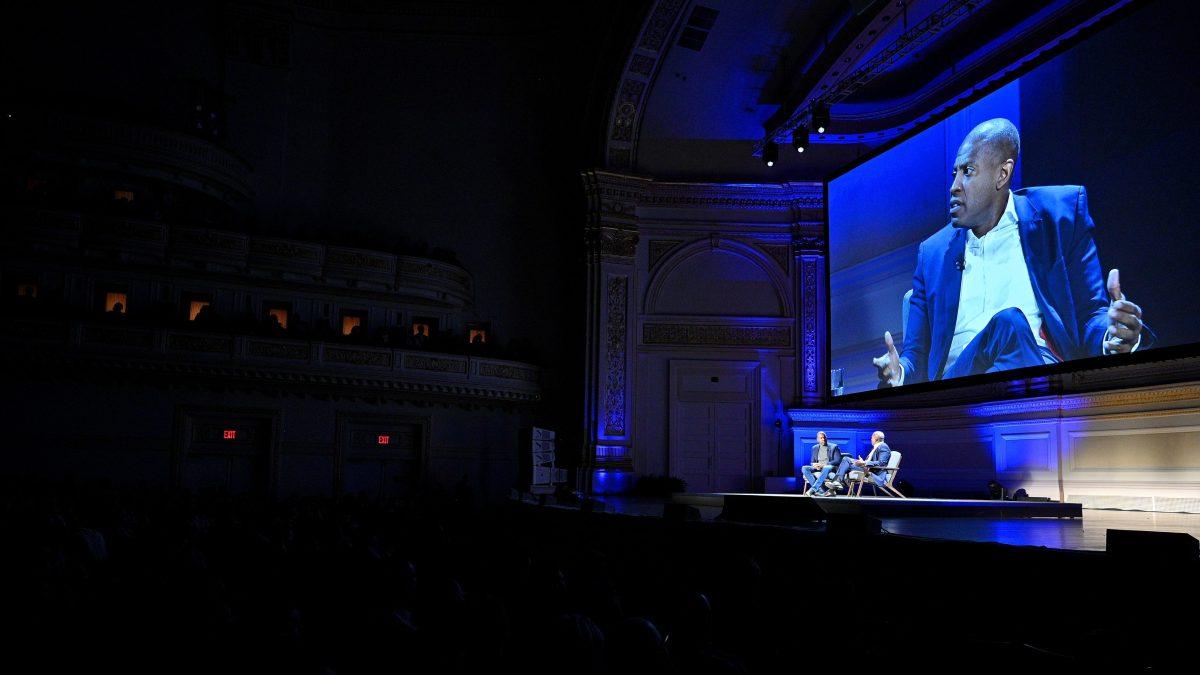 Carlos Watson of Ozy, on a huge screen