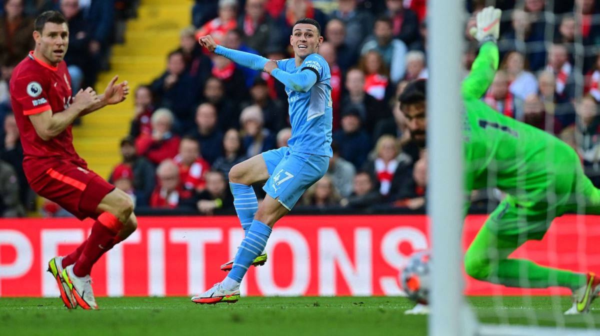 Manchester City's English midfielder Phil Foden (C) scores his team's equalisier during the English Premier League football match between Liverpool and Manchester City at Anfield in Liverpool, northwest England, on October 3, 2021.