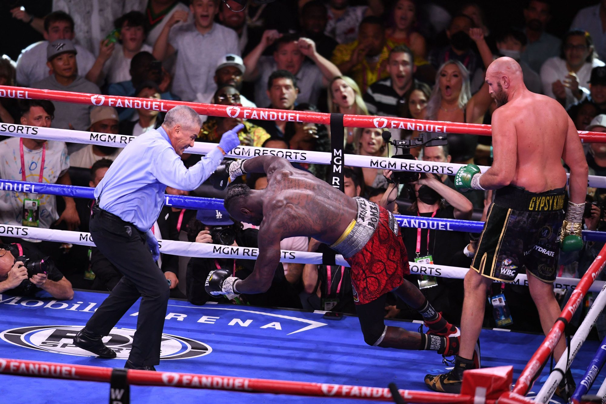 Deontay Wilder falls to the mat