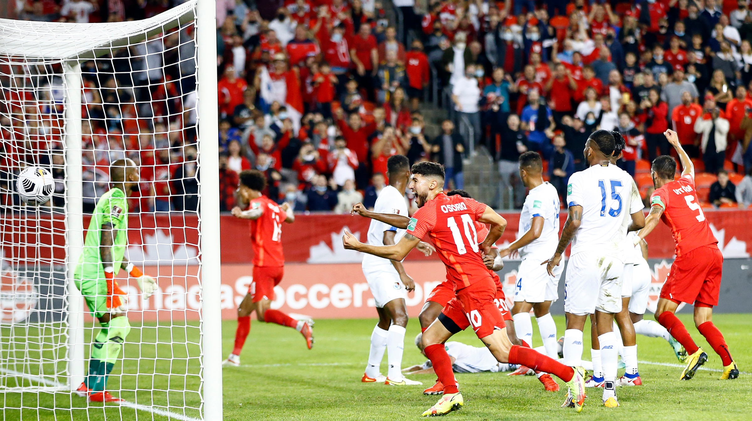 Jonathan Osorio #10 of Canada celebrates a goal by Tajon Buchanan #11 during a 2022 World Cup Qualifying match against Panama at BMO Field on October 13, 2021 in Toronto, Ontario, Canada.