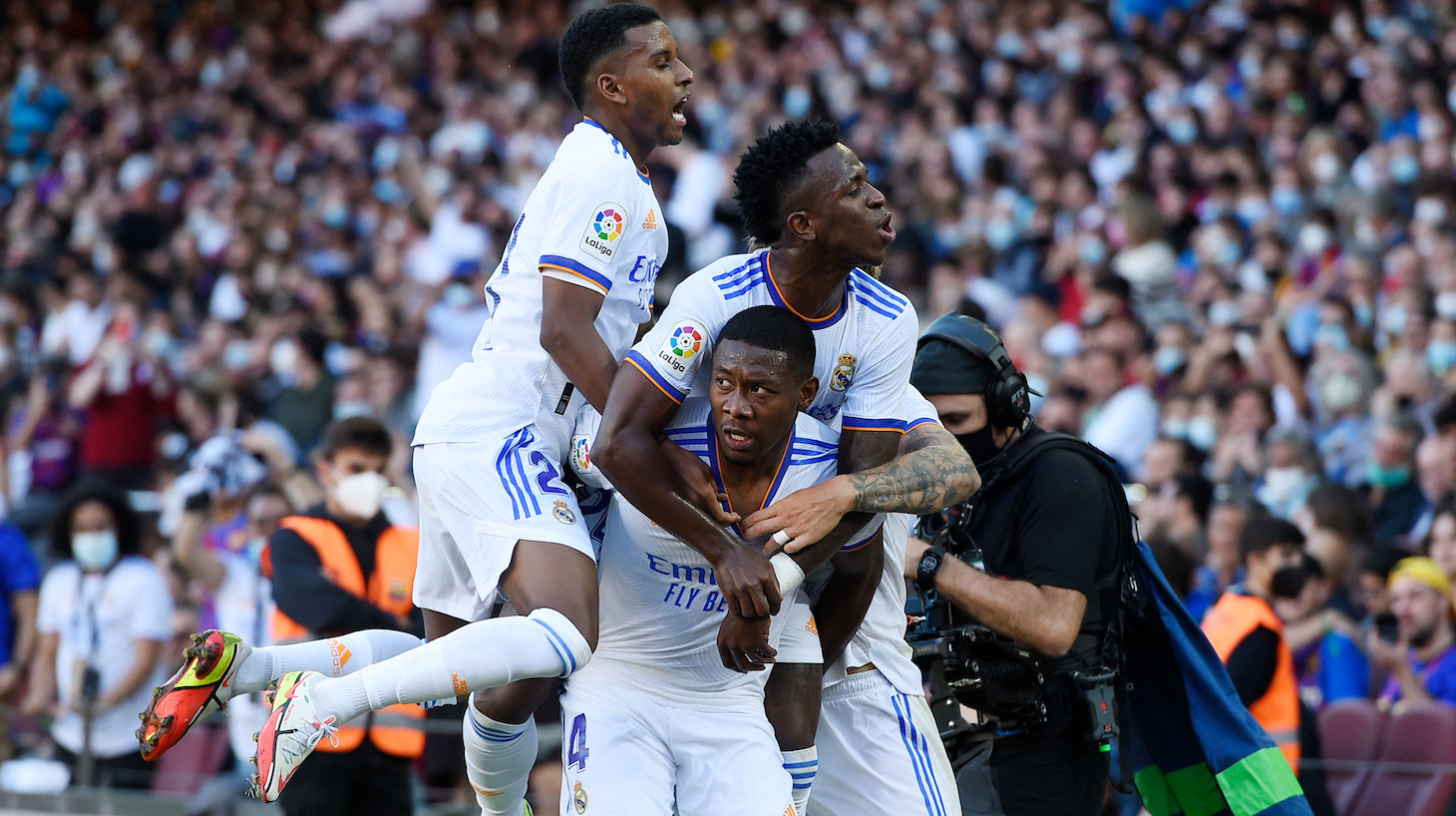 Real Madrid's Austrian defender David Alaba celebrates scoring the opening goal during the Spanish League football match between FC Barcelona and Real Madrid CF at the Camp Nou stadium in Barcelona on October 24, 2021.