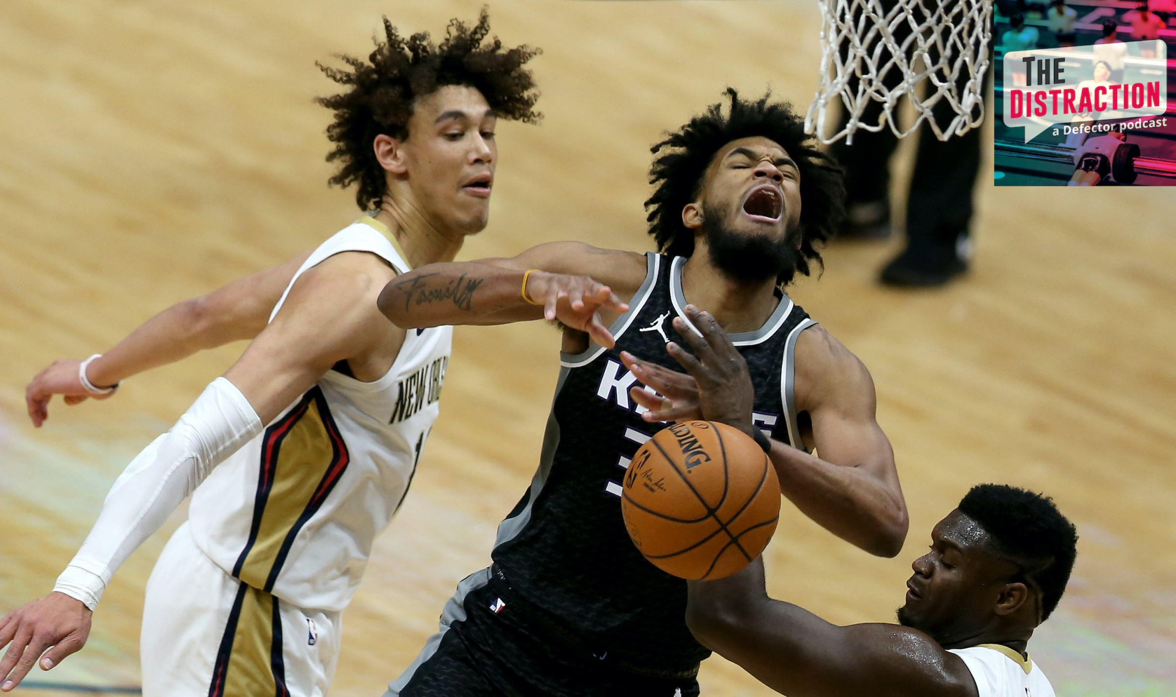 Marvin Bagley is fouled by both Zion Williamson and Jaxson Hayes in a '19-20 NBA game no one on earth remembers.