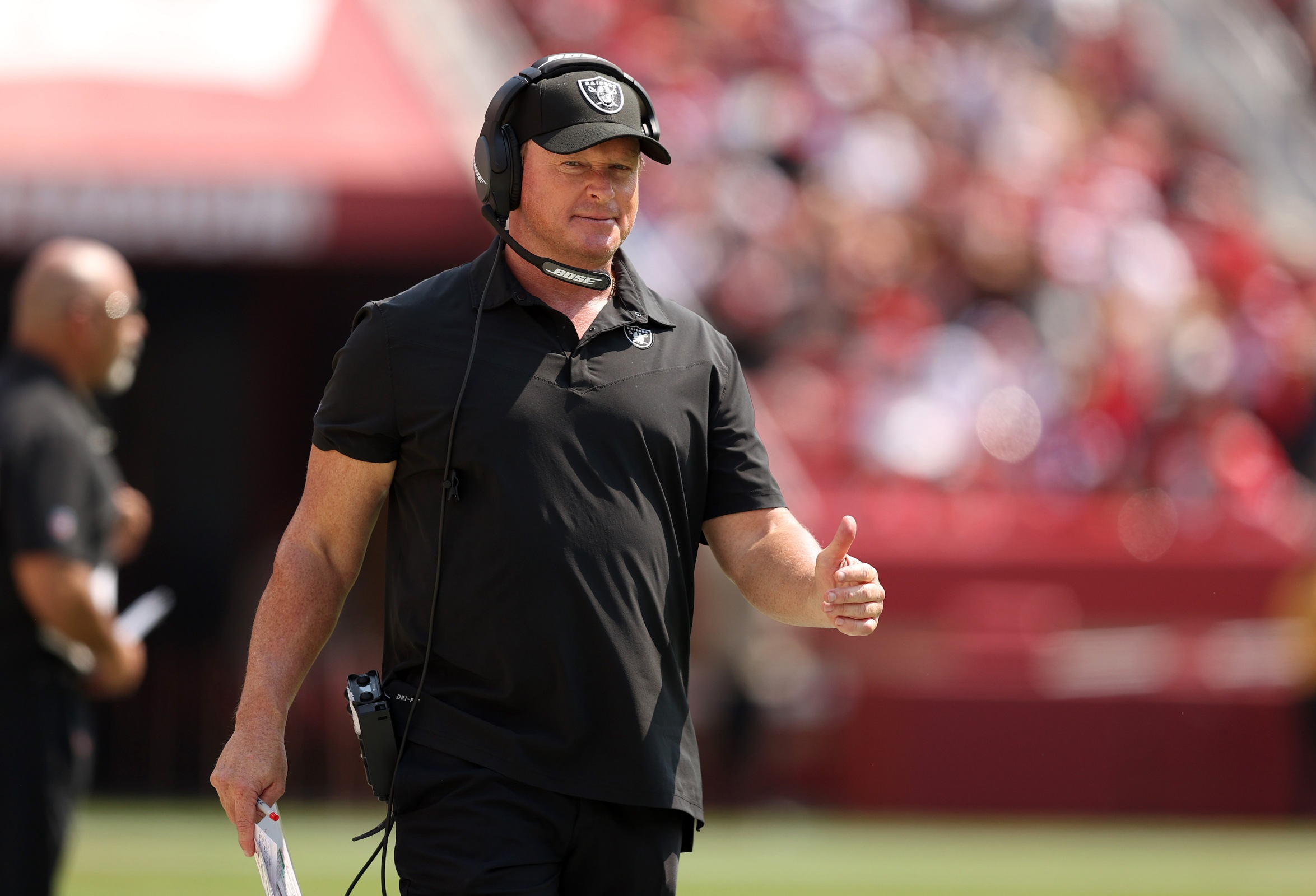 Jon Gruden gives the thumbs-up to sometimes wearing glasses and sometimes not.