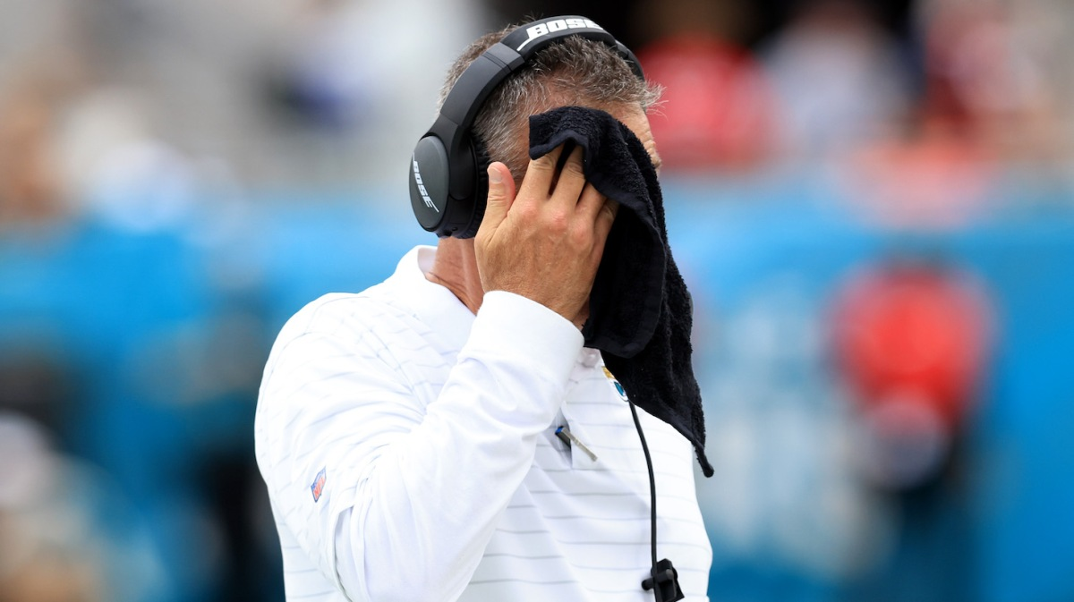JACKSONVILLE, FLORIDA - SEPTEMBER 19: Head coach Urban Meyer of the Jacksonville Jaguars wipes his face with a towel during the game against the Denver Broncos at TIAA Bank Field on September 19, 2021 in Jacksonville, Florida. (Photo by Sam Greenwood/Getty Images)