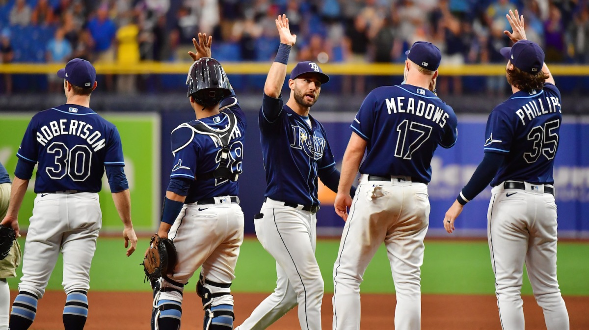 ST PETERSBURG, FLORIDA - SEPTEMBER 22: Kevin Kiermaier #39 of the Tampa Bay Rays celebrates with teammates after defeating the Toronto Blue Jays 7-1 to clinch a playoff berth at Tropicana Field on September 22, 2021 in St Petersburg, Florida. (Photo by Julio Aguilar/Getty Images)