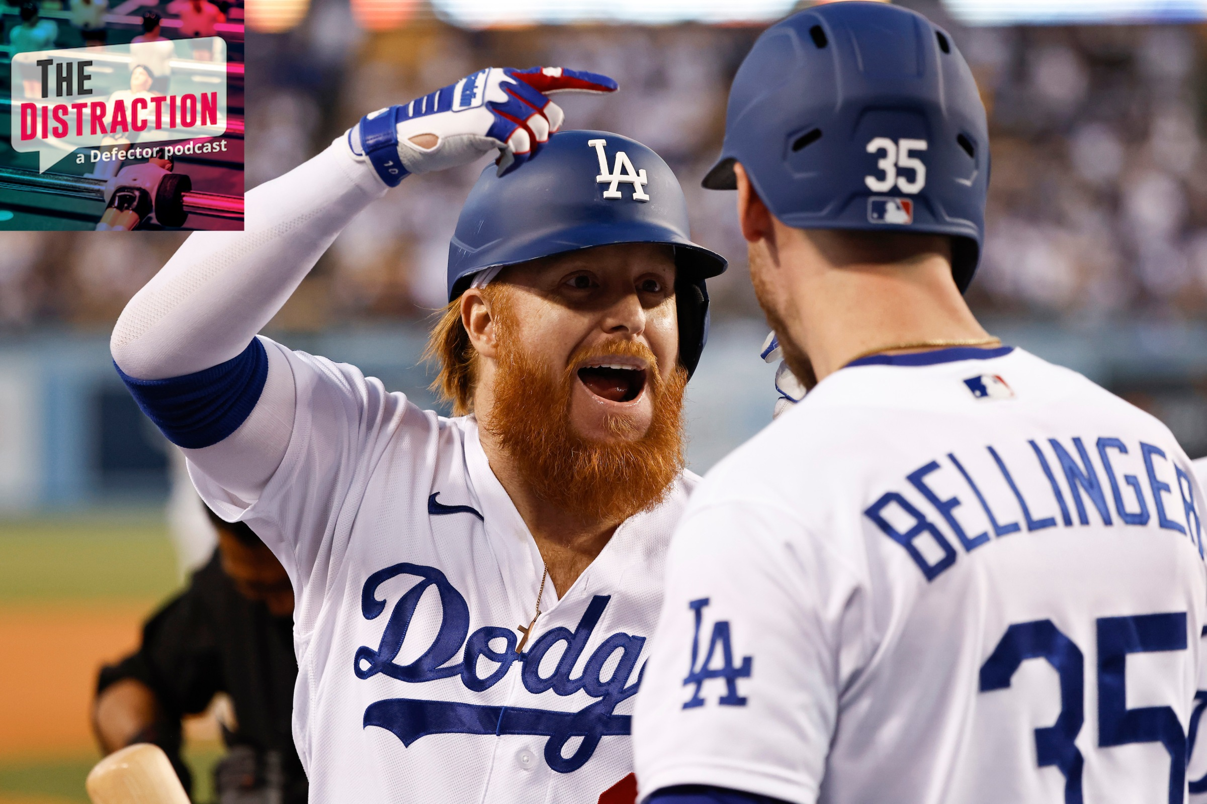 Justin Turner and Cody Bellinger celebrate in a Dodger win.
