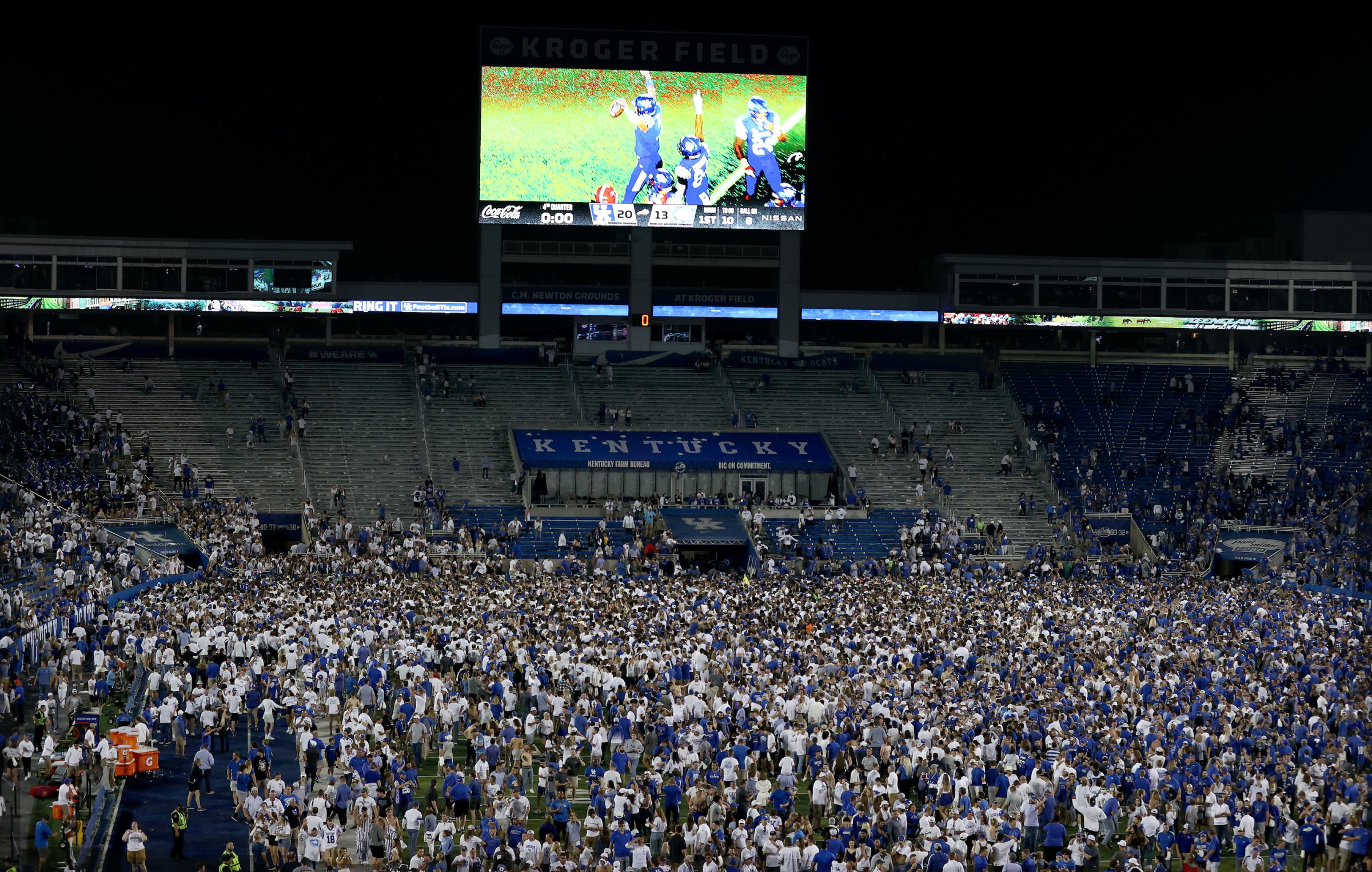 The Kentucky Wildcats fans celebrate on the field after the 20-13 win against the Florida Gators at Kroger Field on October 02, 2021 in Lexington, Kentucky.