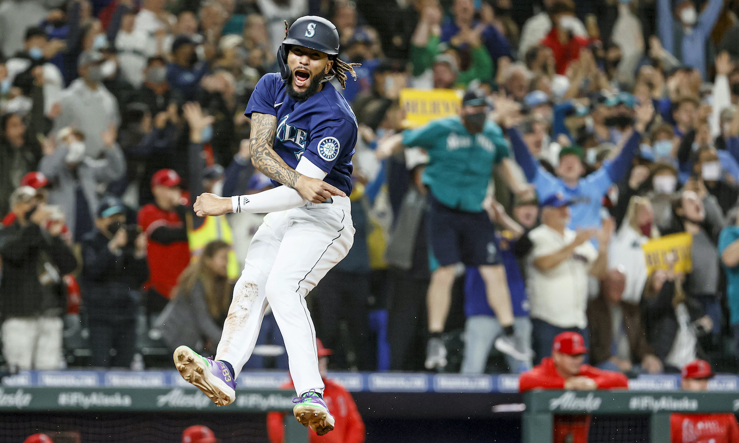 SEATTLE, WASHINGTON - OCTOBER 02: J.P. Crawford #3 of the Seattle Mariners reacts after scoring on a single by Mitch Haniger #17 during the eighth inning against the Los Angeles Angels at T-Mobile Park on October 02, 2021 in Seattle, Washington. (Photo by Steph Chambers/Getty Images)