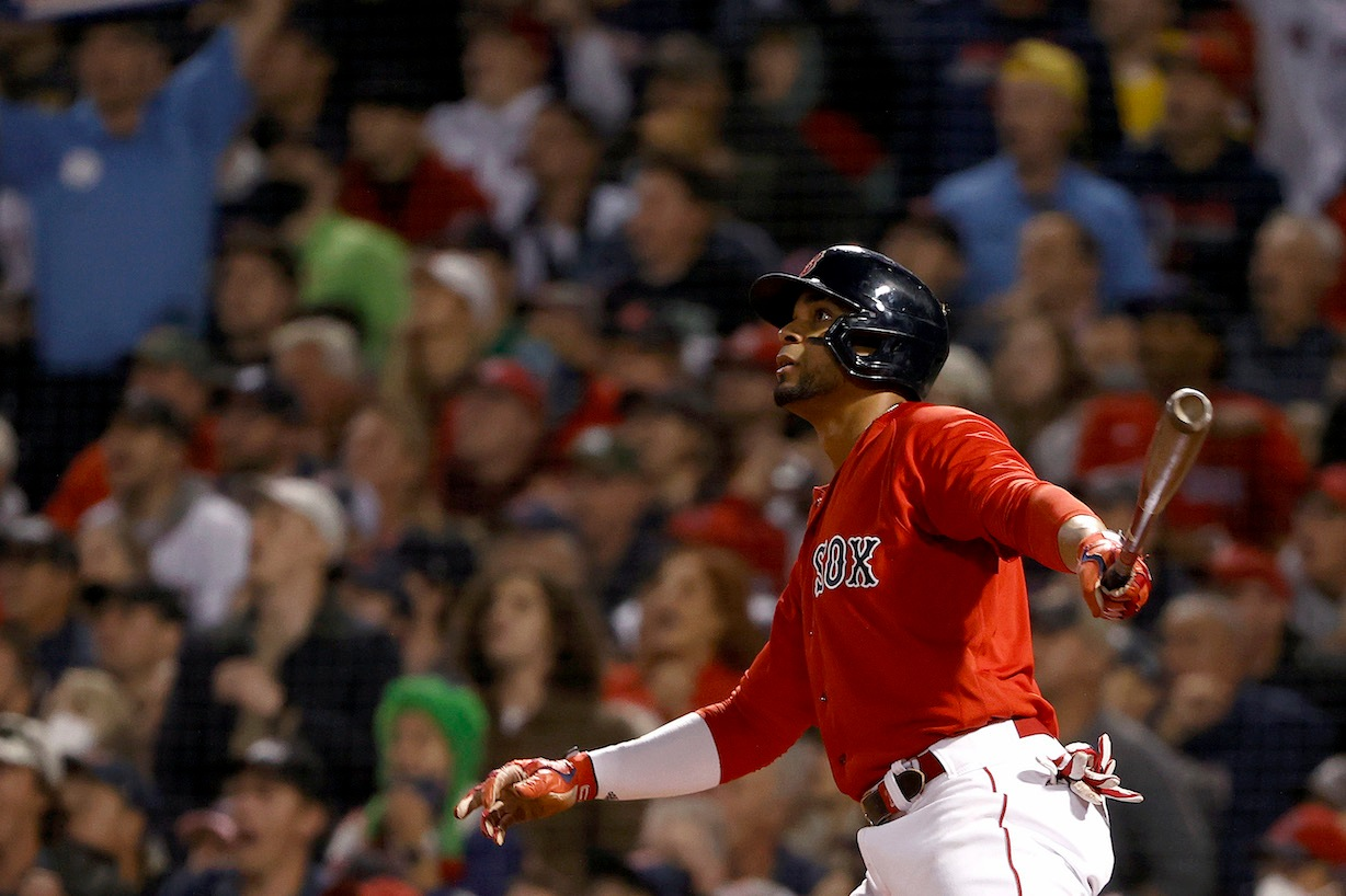 BOSTON, MASSACHUSETTS - OCTOBER 05: Xander Bogaerts #2 of the Boston Red Sox watches his two run home run against the New York Yankees during the first inning of the American League Wild Card game at Fenway Park on October 05, 2021 in Boston, Massachusetts. (Photo by Winslow Townson/Getty Images)