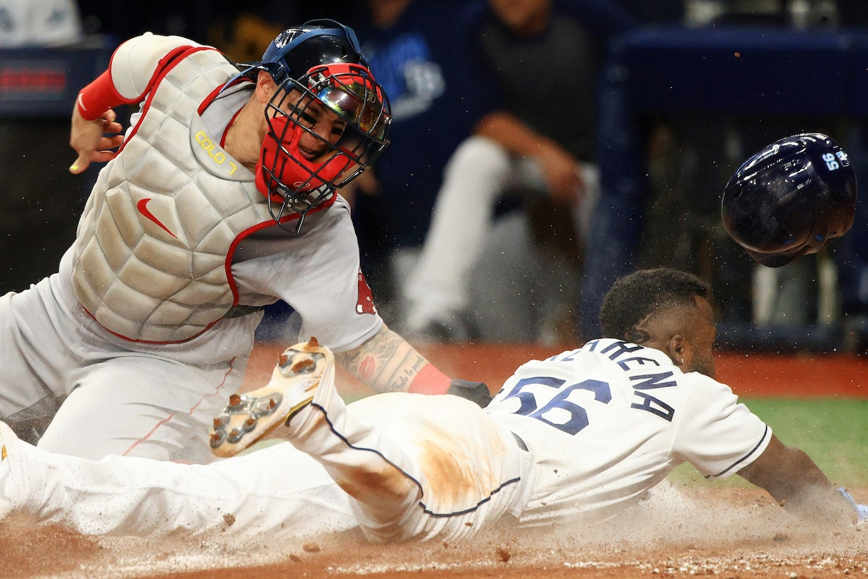 ST PETERSBURG, FLORIDA - OCTOBER 07: Randy Arozarena #56 of the Tampa Bay Rays steals home against Christian Vazquez #7 of the Boston Red Sox in the seventh inning during Game 1 of the American League Division Series at Tropicana Field on October 07, 2021 in St Petersburg, Florida. (Photo by Mike Ehrmann/Getty Images)