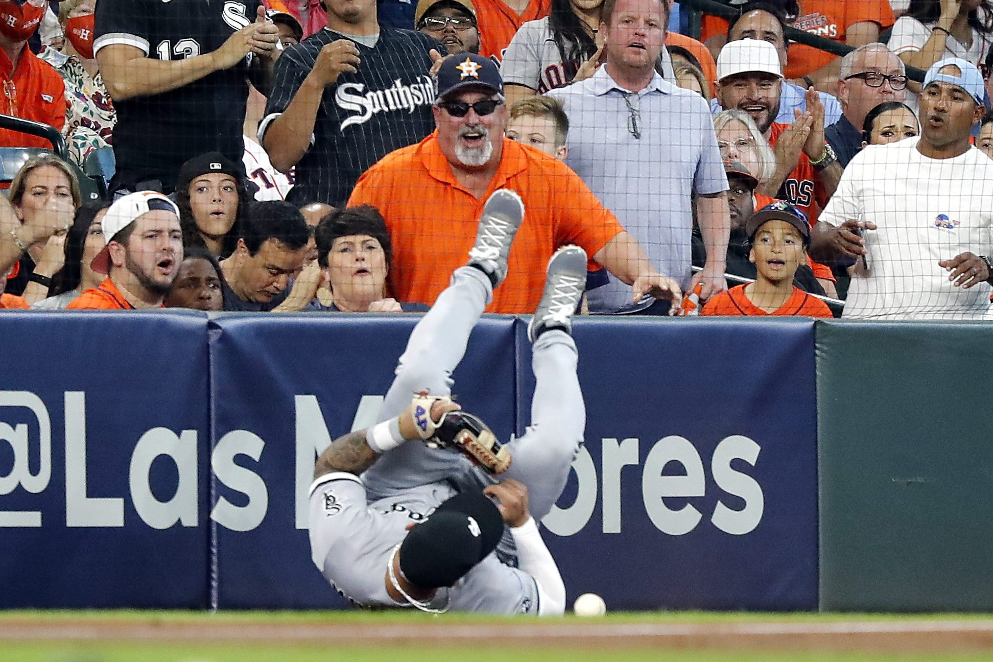 Yoan Moncada of the Chicago White Sox sprawled on the ground in front of jeering Houston Astros fans