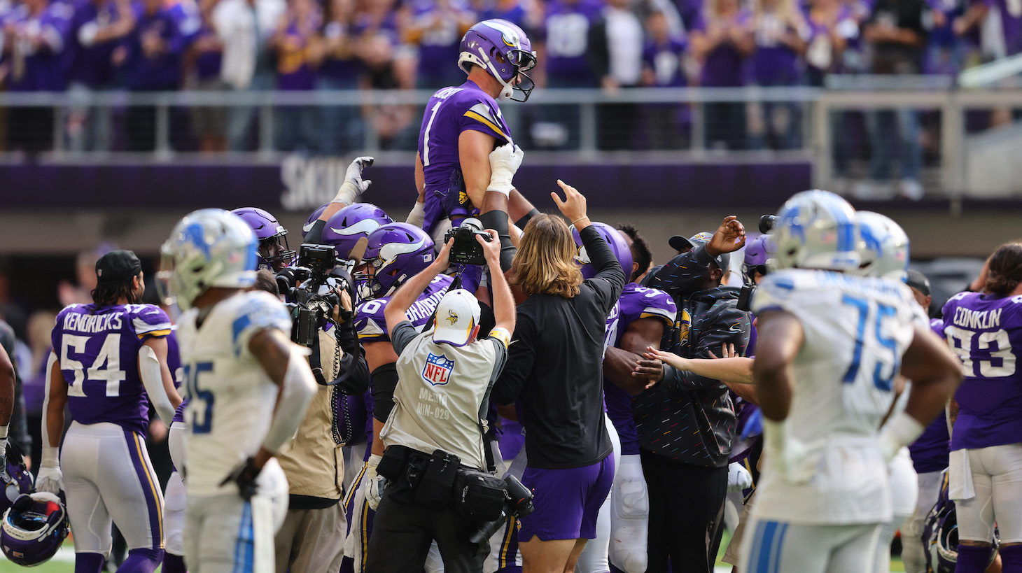 MINNEAPOLIS, MINNESOTA - OCTOBER 10: Greg Joseph #1 of the Minnesota Vikings is carried off the field by teammates after kicking the game winning field goal against the Detroit Lions at U.S. Bank Stadium on October 10, 2021 in Minneapolis, Minnesota. (Photo by Adam Bettcher/Getty Images)