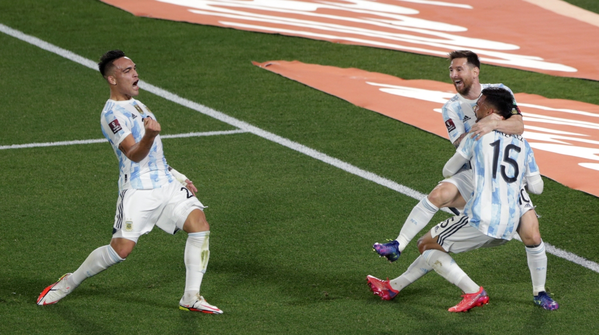 Lionel Messi of Argentina celebrates with teammate Nicolás Gonzalez after scoring the first goal of his team during a match between Argentina and Uruguay as part of South American Qualifiers for Qatar 2022 at Estadio Monumental Antonio Vespucio Liberti on October 10, 2021 in Buenos Aires, Argentina.