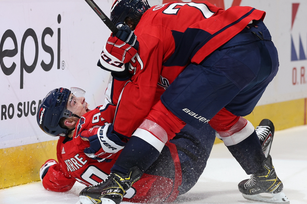 WASHINGTON, DC - OCTOBER 13: Hendrix Lapierre #29 of the Washington Capitals (L) celebrates his first career NHL goal with teammate T.J. Oshie #77 against the New York Rangers during the second period at Capital One Arena on October 13, 2021 in Washington, DC. (Photo by Patrick Smith/Getty Images)