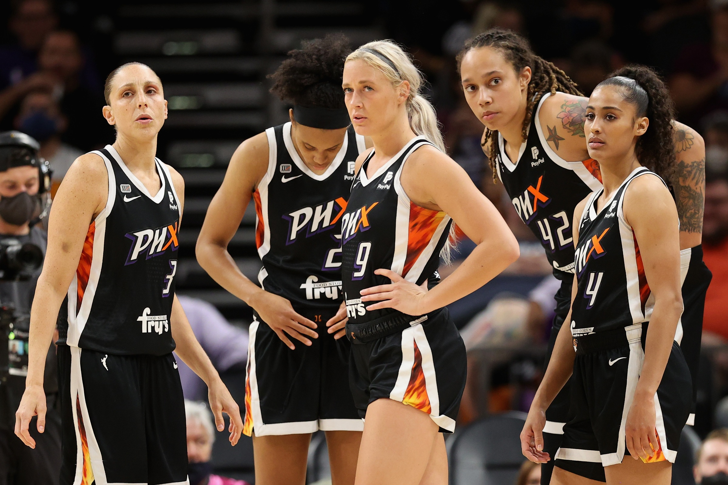 (L-R) Diana Taurasi #3, Brianna Turner #21, Sophie Cunningham #9, Brittney Griner #42 and Skylar Diggins-Smith #4 of the Phoenix Mercury stand on the court during the second half in Game Two of the 2021 WNBA Finals against the Chicago Sky at Footprint Center on October 13, 2021 in Phoenix, Arizona. The Mercury defeated the Sky 91-86 in overtime.