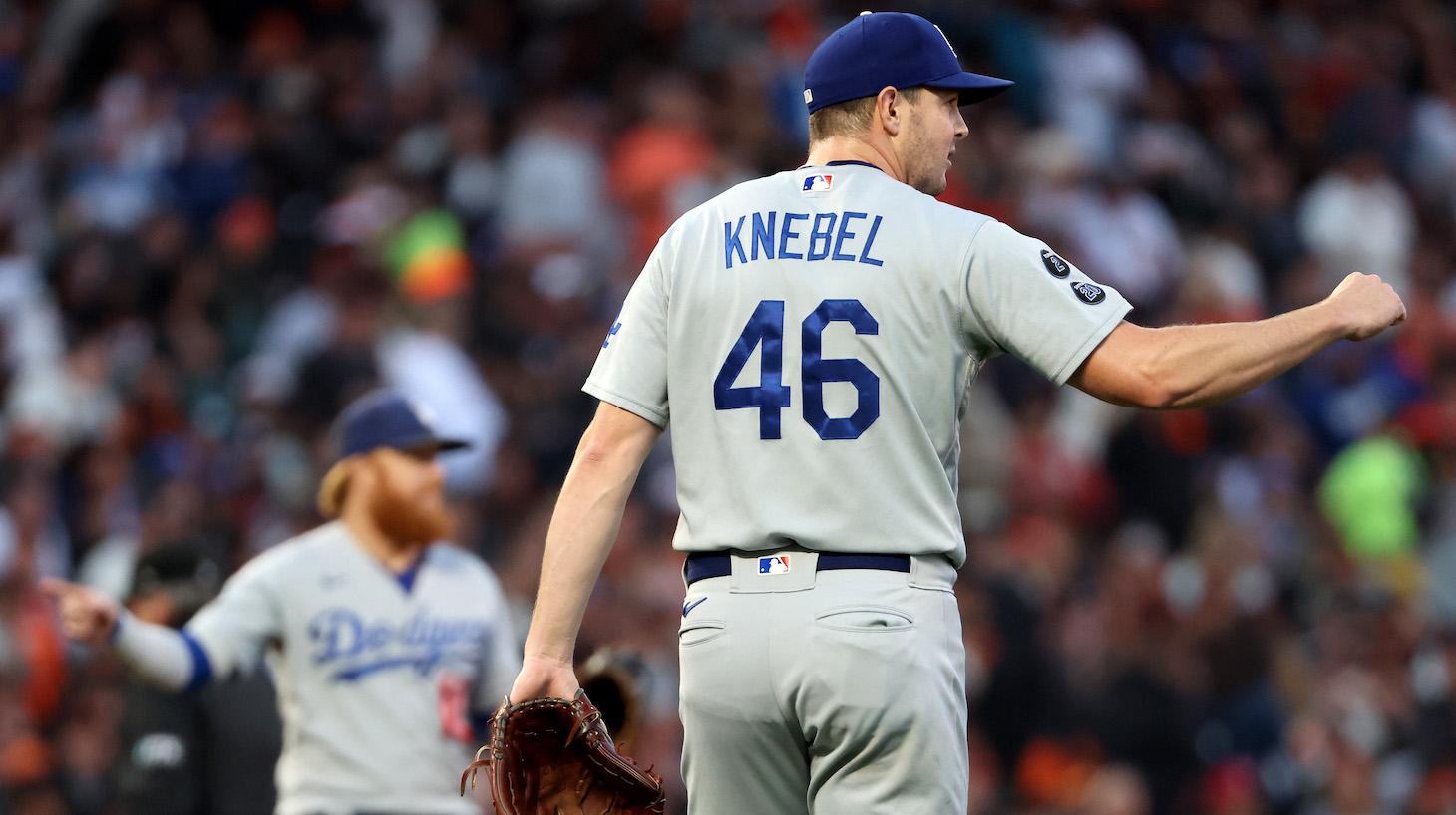 SAN FRANCISCO, CALIFORNIA - OCTOBER 14: Corey Knebel #46 of the Los Angeles Dodgers reacts after an out against against Darin Ruf #33 of the San Francisco Giants during the first inning in game 5 of the National League Division Series at Oracle Park on October 14, 2021 in San Francisco, California. (Photo by Harry How/Getty Images)