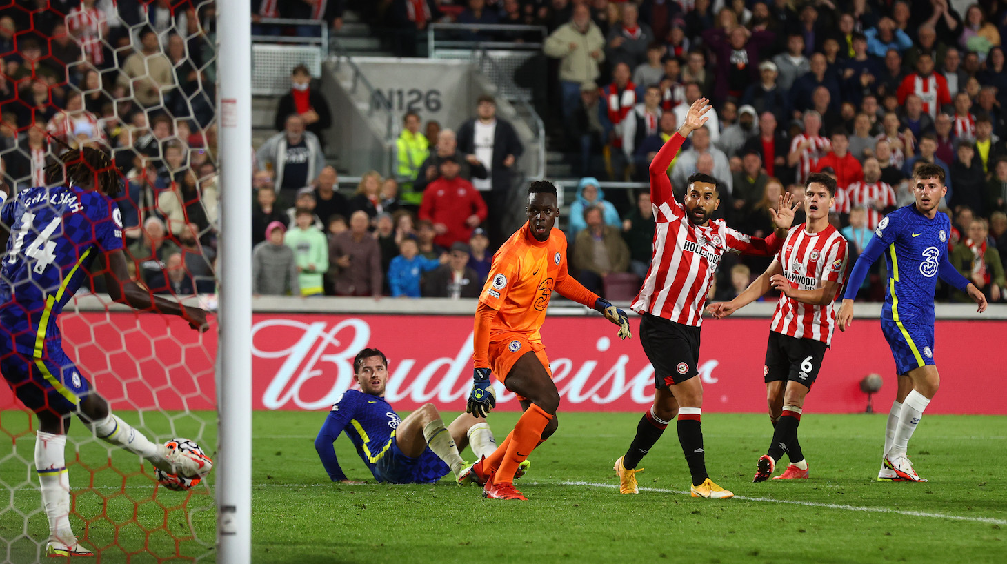 Trevoh Chalobah of Chelsea clears the ball off the line to prevent a goal during the Premier League match between Brentford and Chelsea at Brentford Community Stadium on October 16, 2021 in Brentford, England.