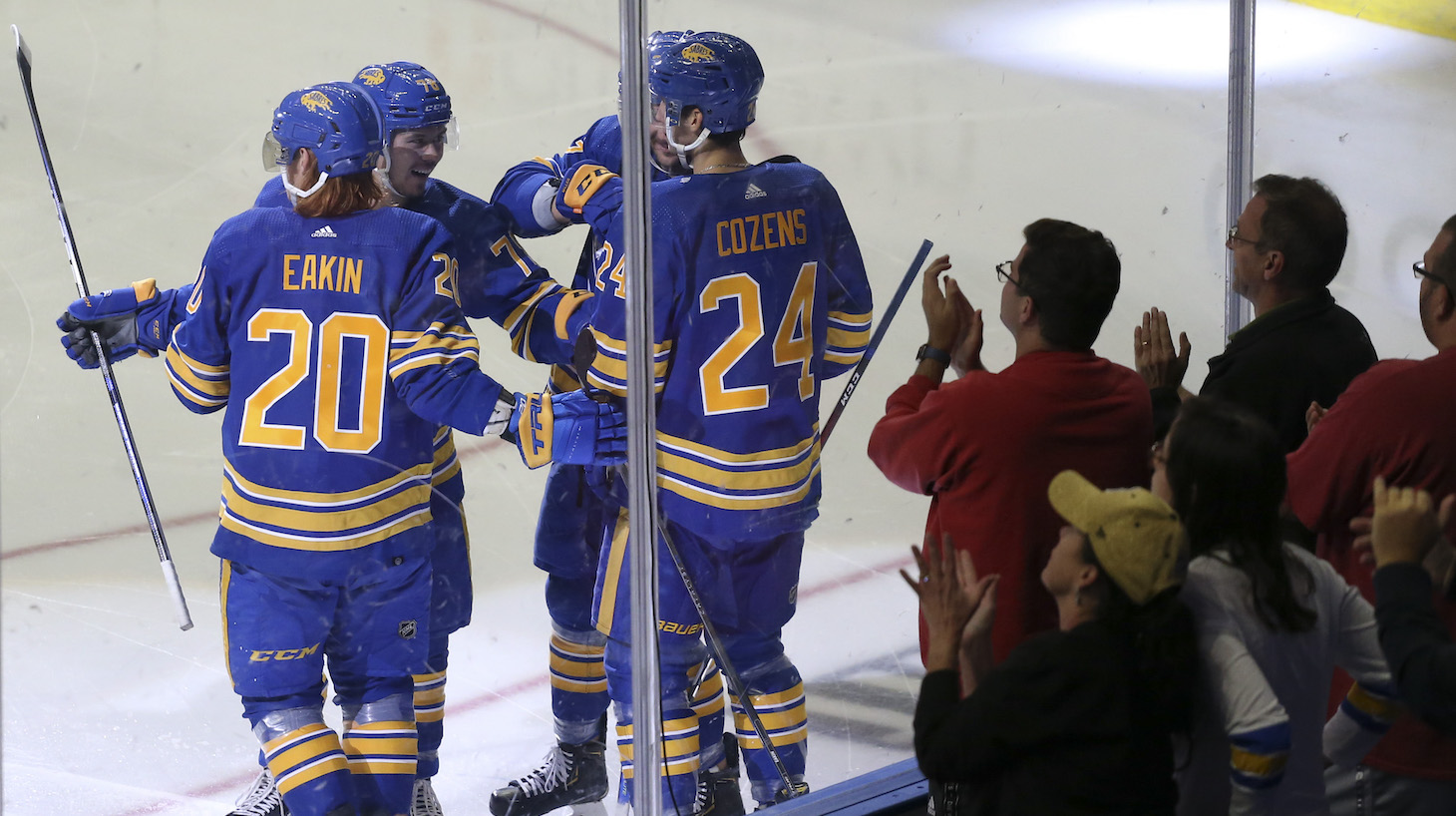 BUFFALO, NEW YORK - OCTOBER 16: Buffalo Sabres players celebrate a goal by Cody Eakin #20 during the second period of a NHL hockey game against the Arizona Coyotes at KeyBank Center on October 16, 2021 in Buffalo, New York. (Photo by Joshua Bessex/Getty Images)