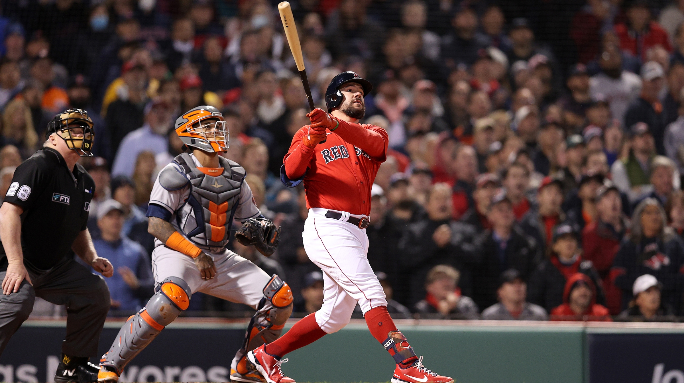 Kyle Schwarber #18 of the Boston Red Sox hits a grand slam home run against the Houston Astros in the second inning of Game Three of the American League Championship Series at Fenway Park on October 18, 2021 in Boston, Massachusetts.