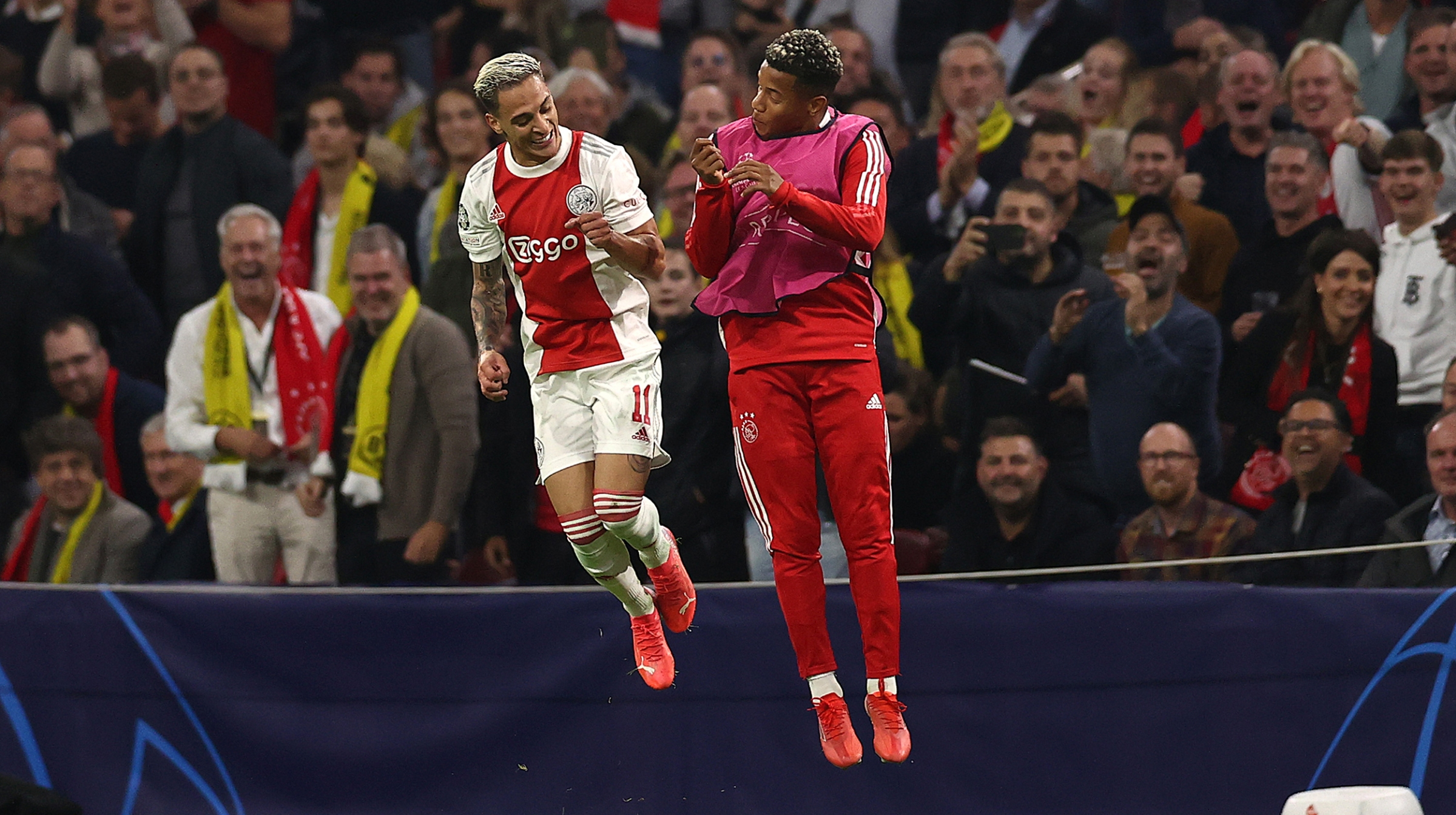 Antony of Ajax celebrates with David Neres after scoring their side's third goal during the UEFA Champions League group C match between AFC Ajax and Borussia Dortmund at Amsterdam Arena on October 19, 2021 in Amsterdam, Netherlands.