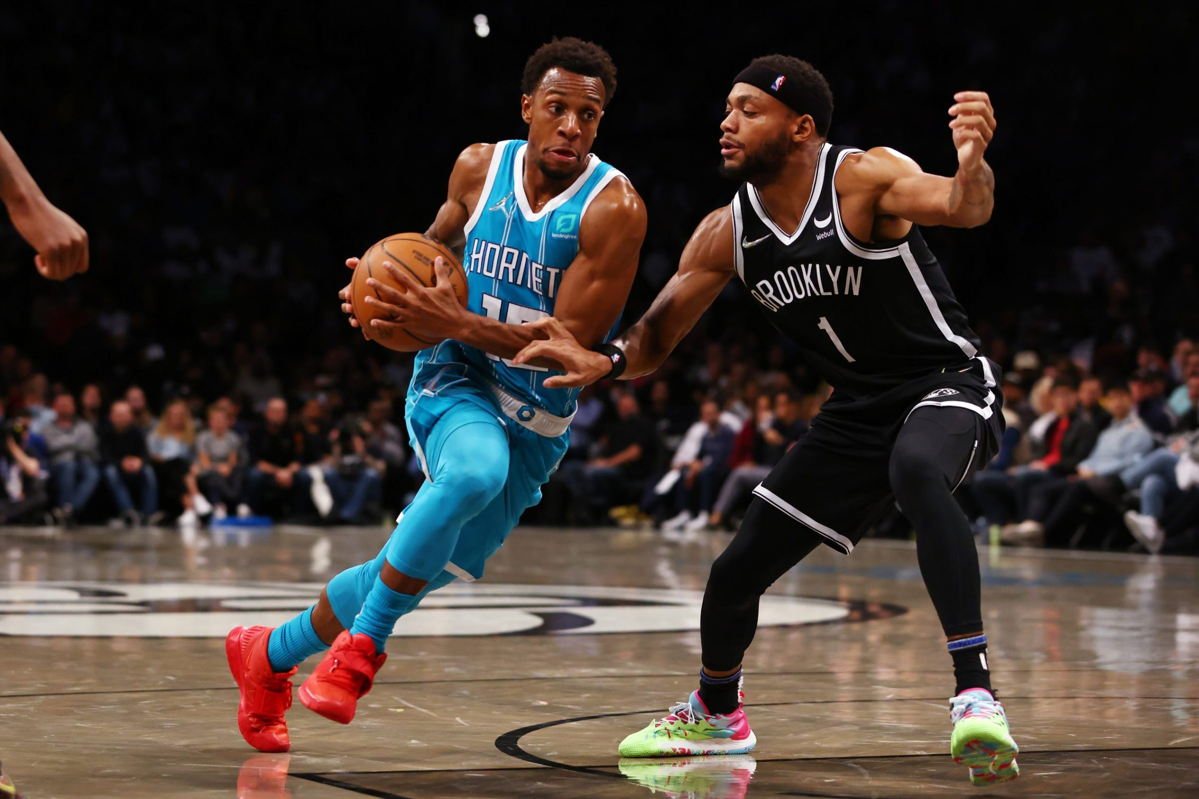 Ish Smith #10 of the Charlotte Hornets in action against Bruce Brown #1 of the Brooklyn Nets during a game at Barclays Center on October 24, 2021 in New York City.