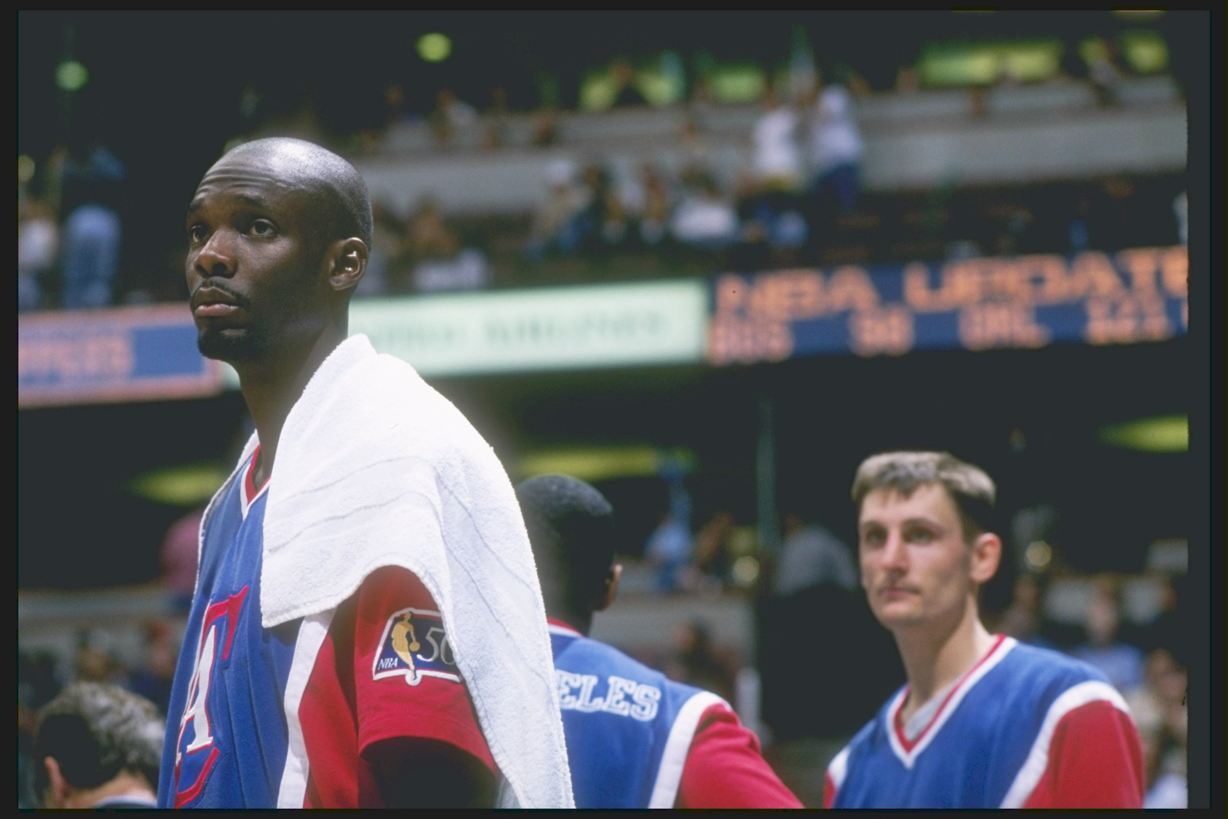 The late Malik Sealy and Brent Barry at a Los Angeles Clippers game in the Arrowhead Pond, in 1997.
