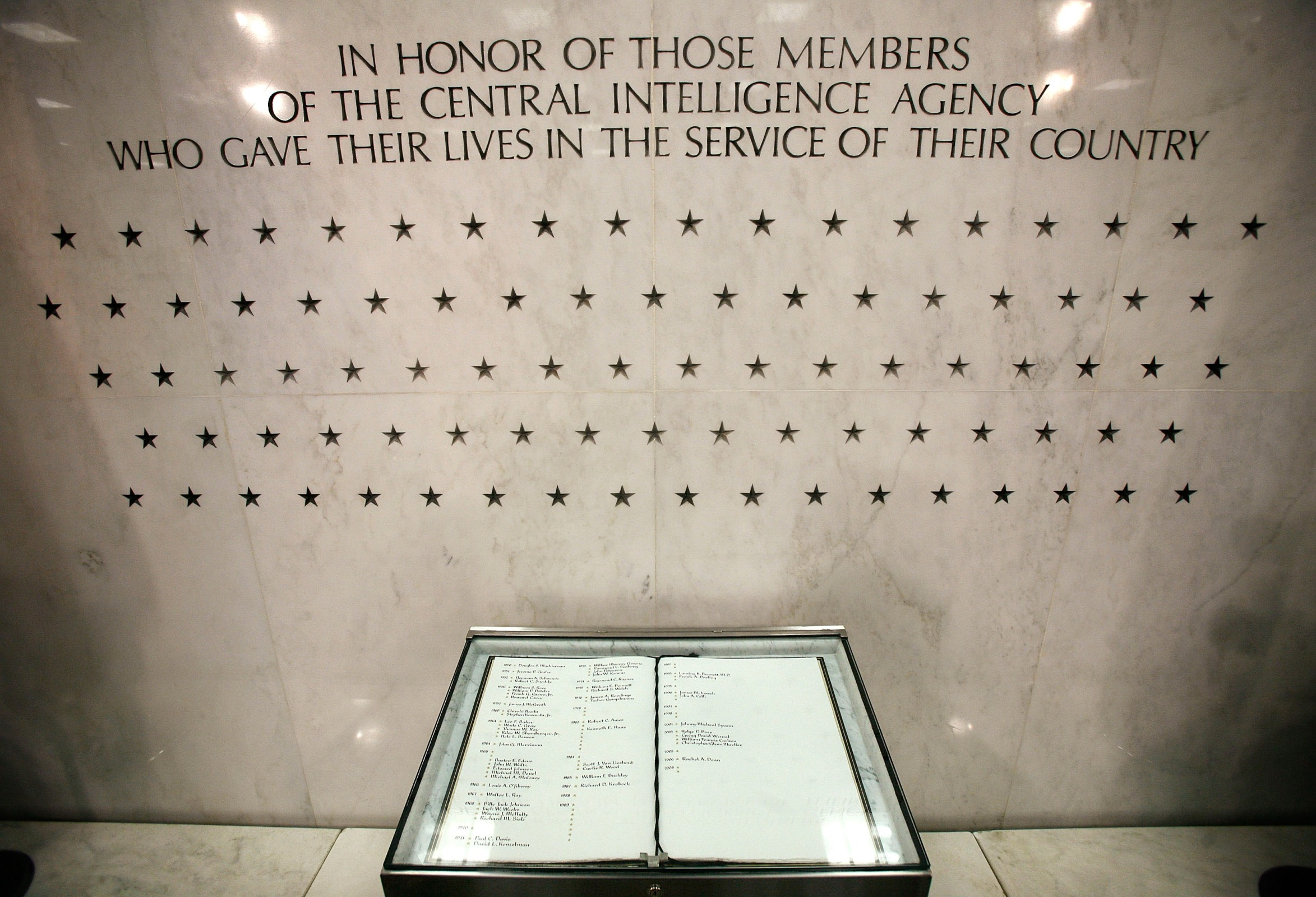 """MCLEAN, VA - FEBRUARY 19: The Memorial Wall and the """"Book of Honor"""" are seen in the lobby of the Original Headquarters Building at the Central Intelligence Agency headquarters February 19, 2009 in McLean, Virginia. The stars on the wall represent the number of CIA officers who have lost their lives for the country. (Photo by Alex Wong/Getty Images)"""