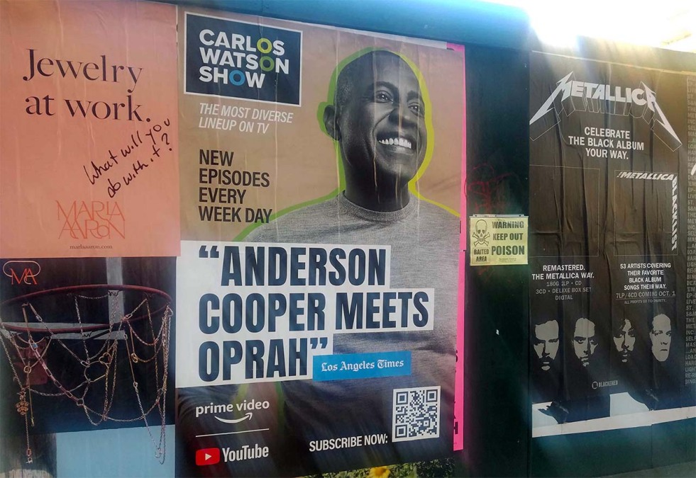 """An ad for the Carlos Watson show. A quote calls him """"Anderson Cooper Meets Oprah"""" on it."""