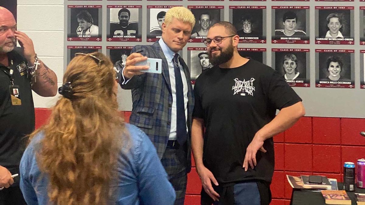 Cody Rhodes taking a selfie with a fan