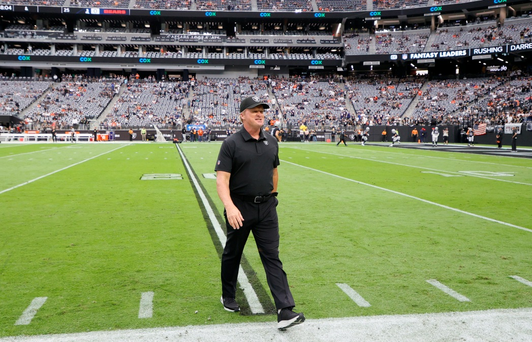 Head coach John Gruden of the Las Vegas Raiders walks on the field before a game against the Chicago Bears at Allegiant Stadium.