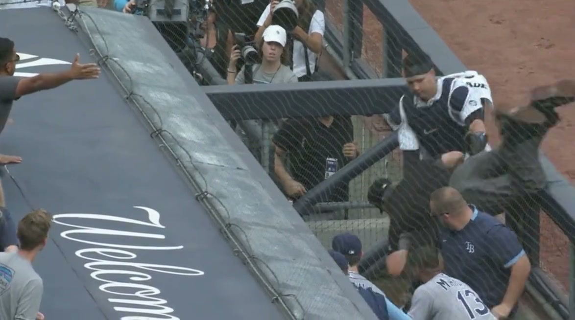 A dugout scene, overhead from 3/4 perspective. An umpire is falling over the dugout railing and into the dugout