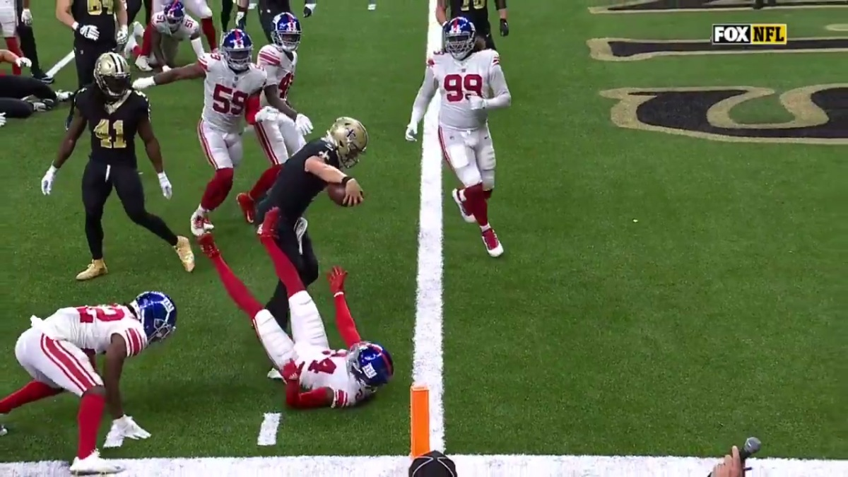 Two Giants players on the ground, Taysom Hill near the goal line, standing up